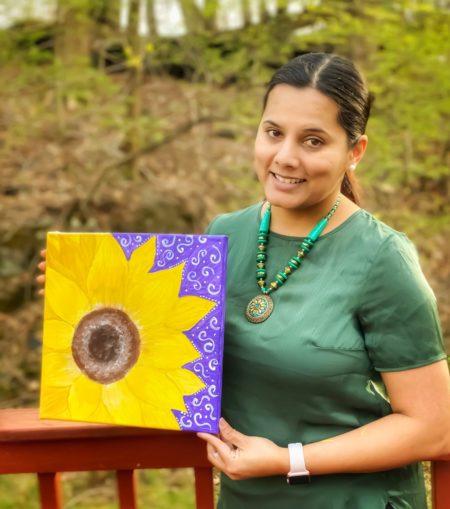 Leena Karande-Gore holding henna art